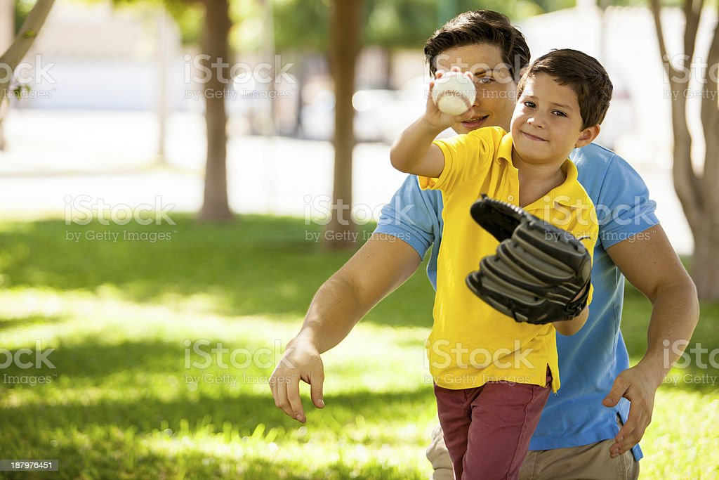 Father and son playing baseball stock photo