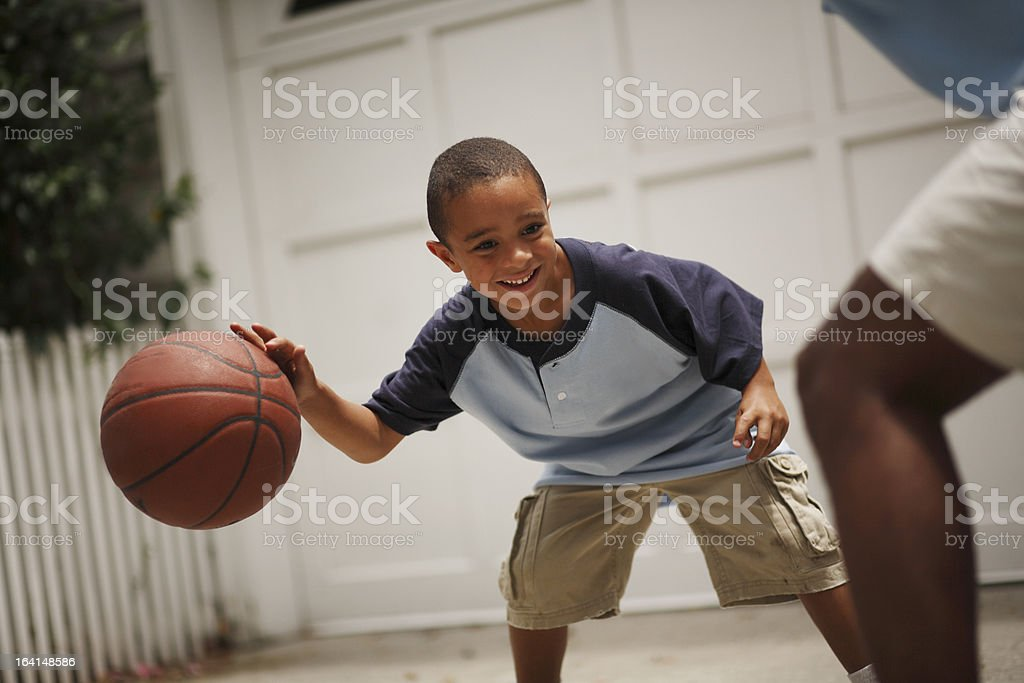 Father and son playing basketball royalty-free stock photo
