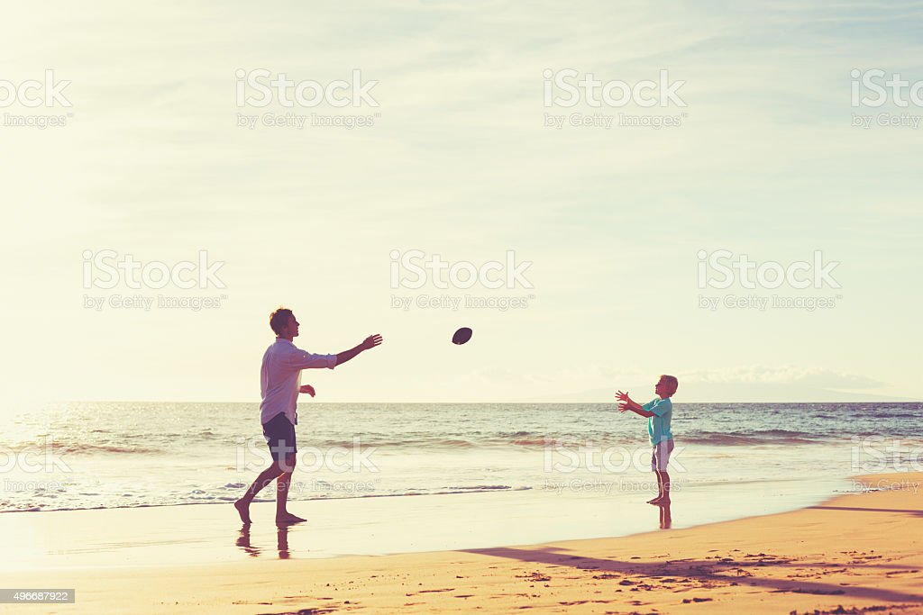 Father and Son Playing Catch Throwing Football stock photo