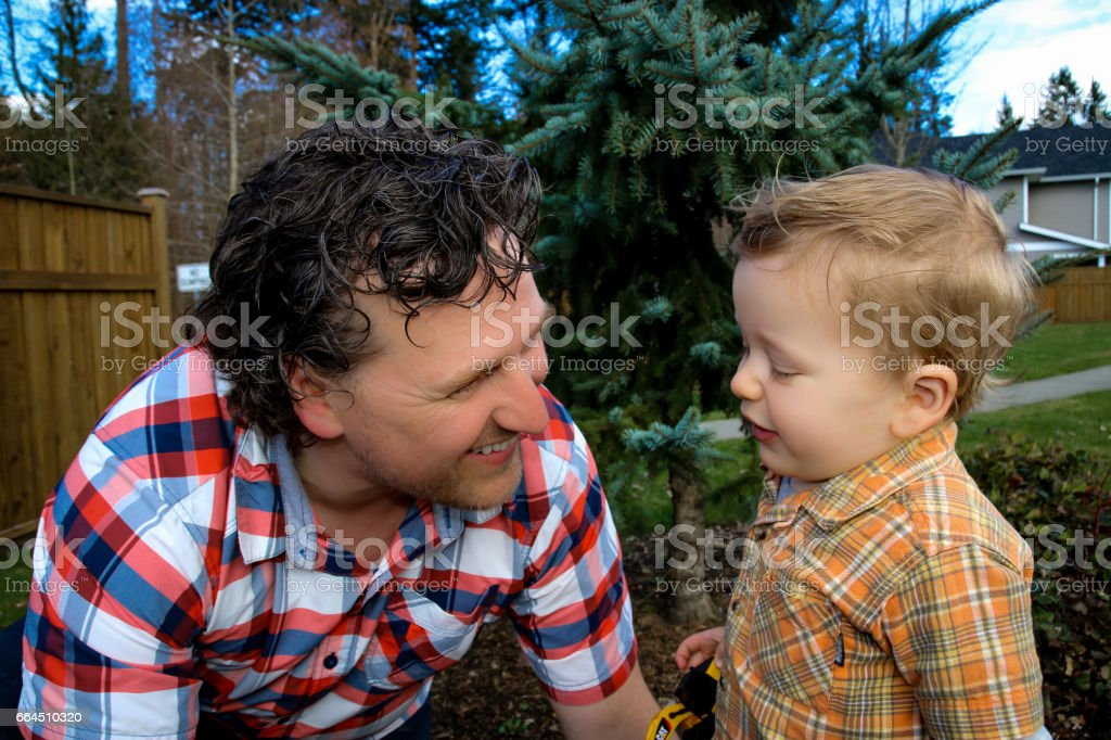 Father and son playing joyfully stock photo