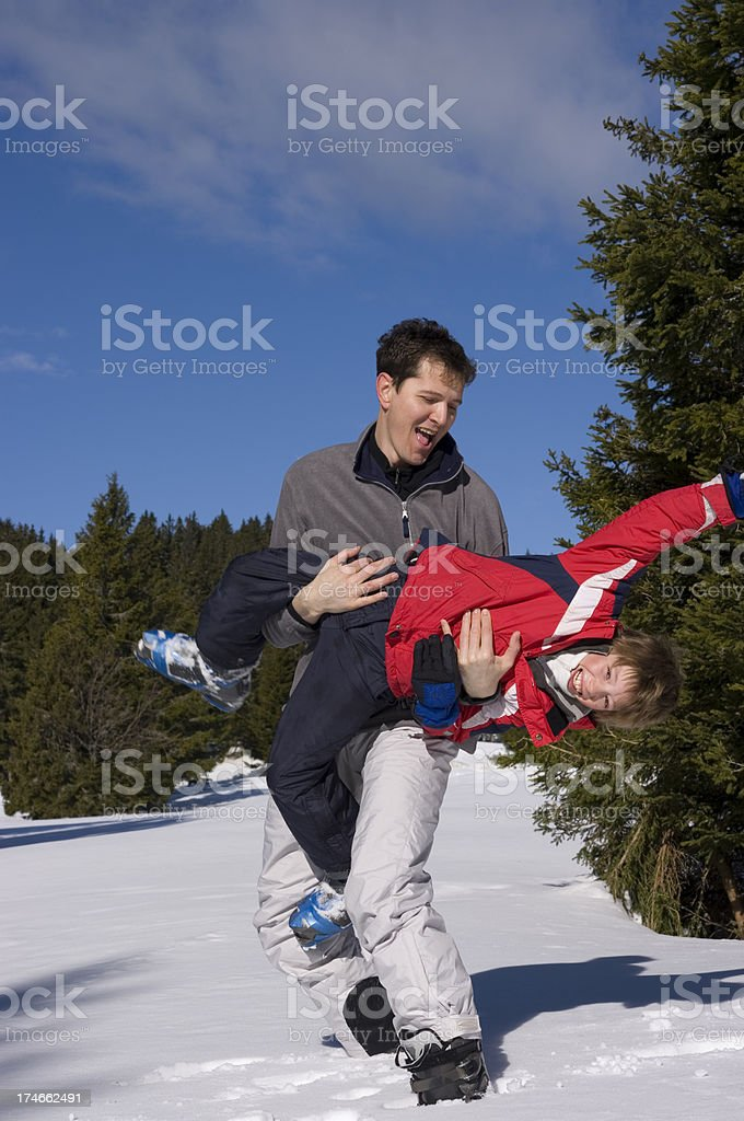 Father and son – playing on snow royalty-free stock photo