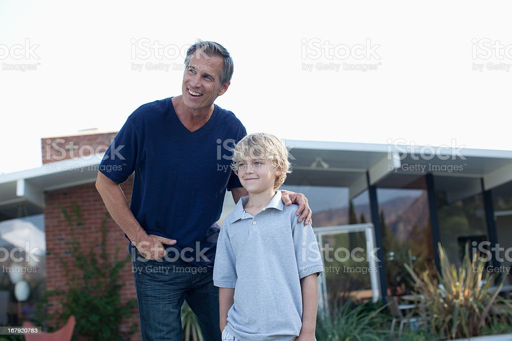 Father and son playing outdoors royalty-free stock photo