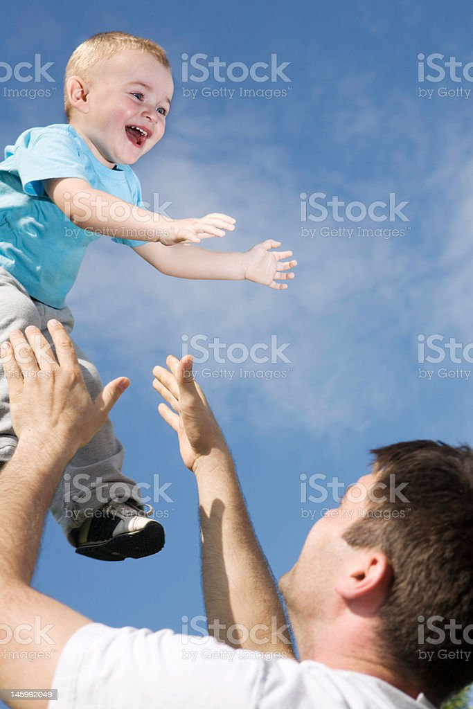 father and son playing royalty-free stock photo