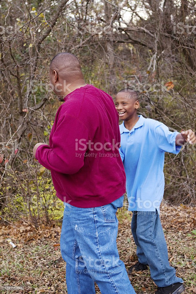 Father and son playing together royalty-free stock photo