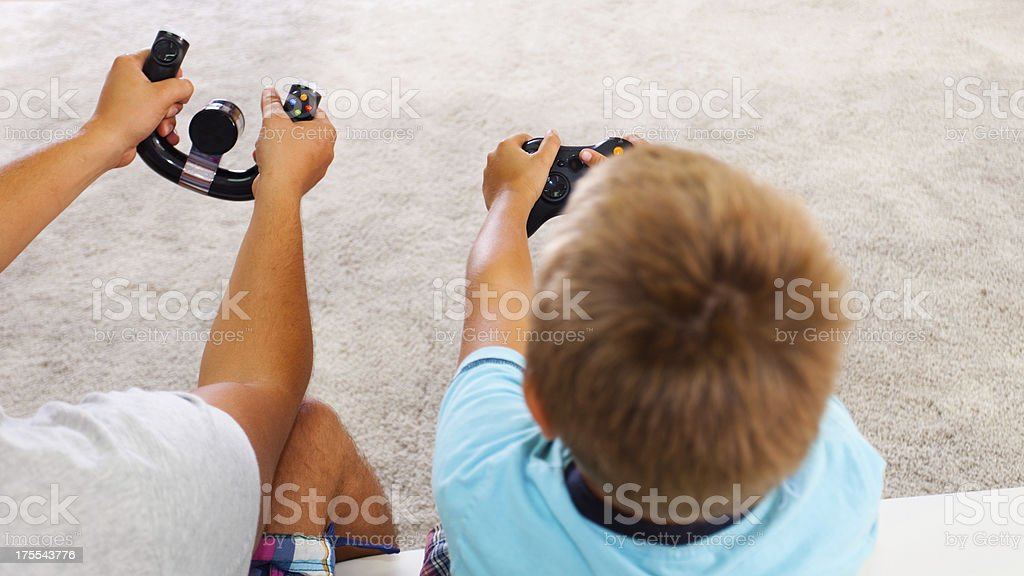 Father and son playing video games. royalty-free stock photo