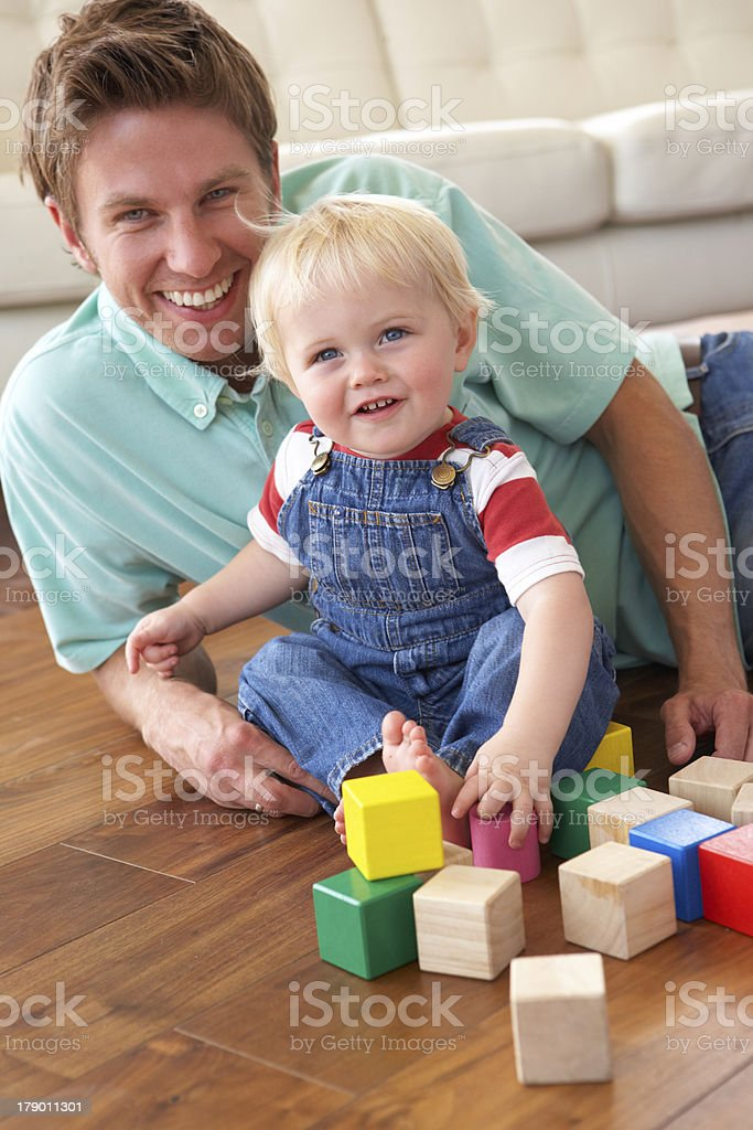 Father And Son Playing With Coloured Blocks At Home royalty-free stock photo