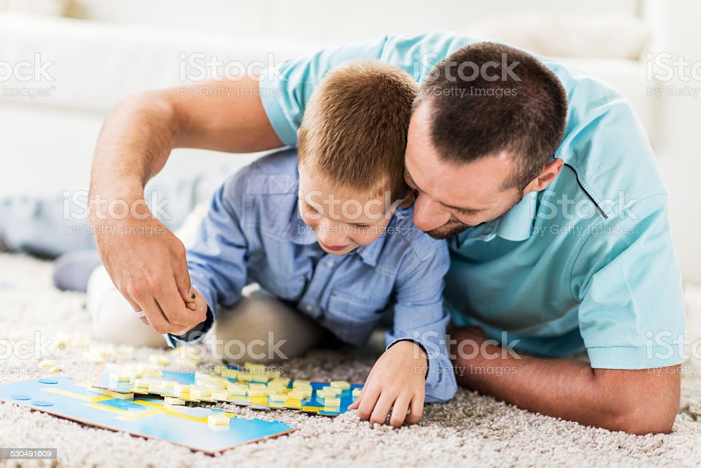 Father and son playing word game. stock photo