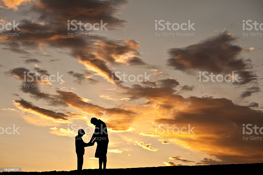 Father and Son Praying stock photo
