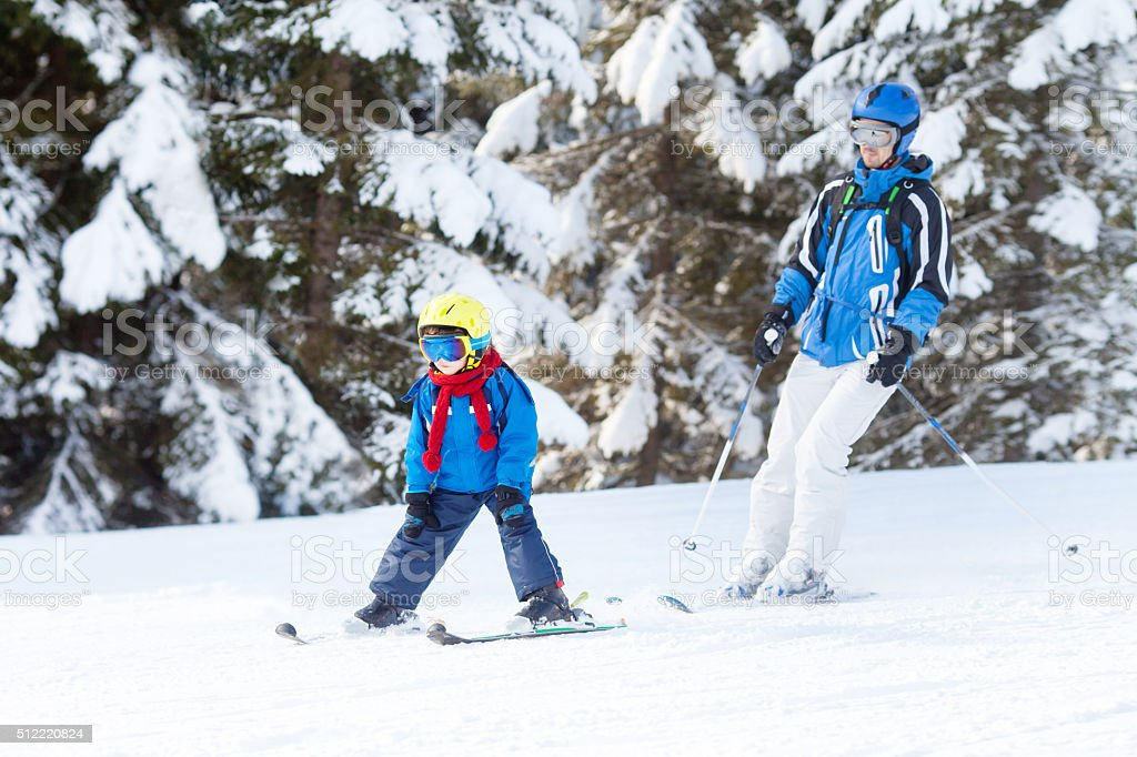 Father and son, preschool child, skiing in Austria stock photo