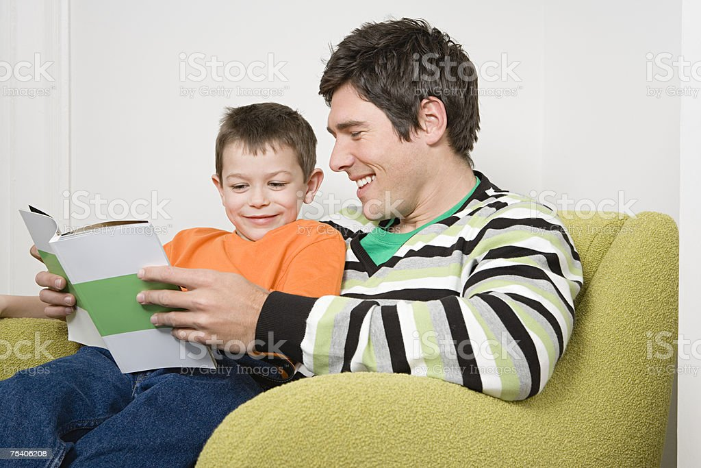 Father and son reading royalty-free stock photo