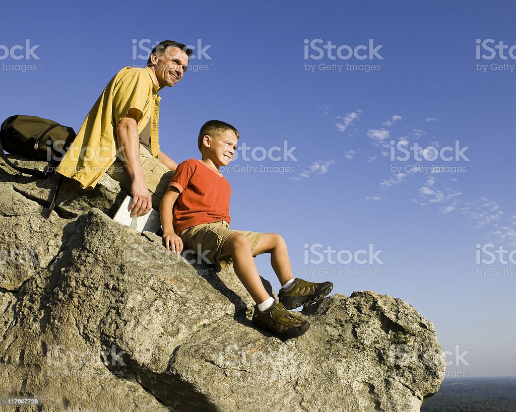 Father and Son Resting on Mountain Top royalty-free stock photo