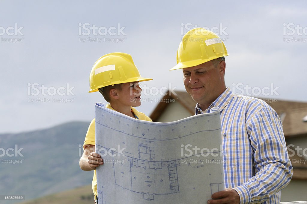 Father and Son Review Plans royalty-free stock photo
