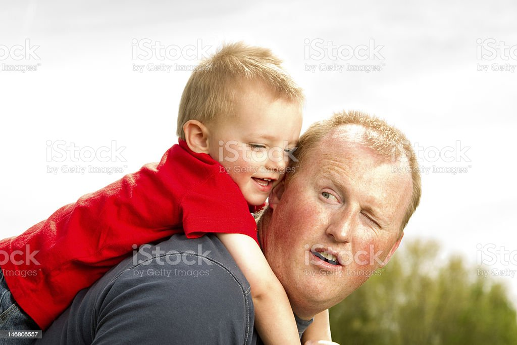 Father and Son Riding Piggyback royalty-free stock photo