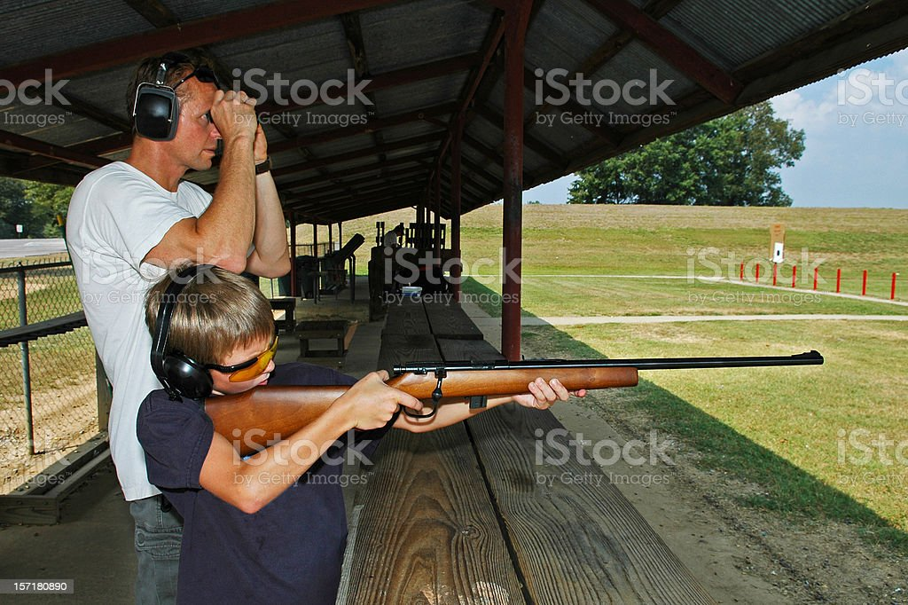 Father and Son Rifle Lessons stock photo