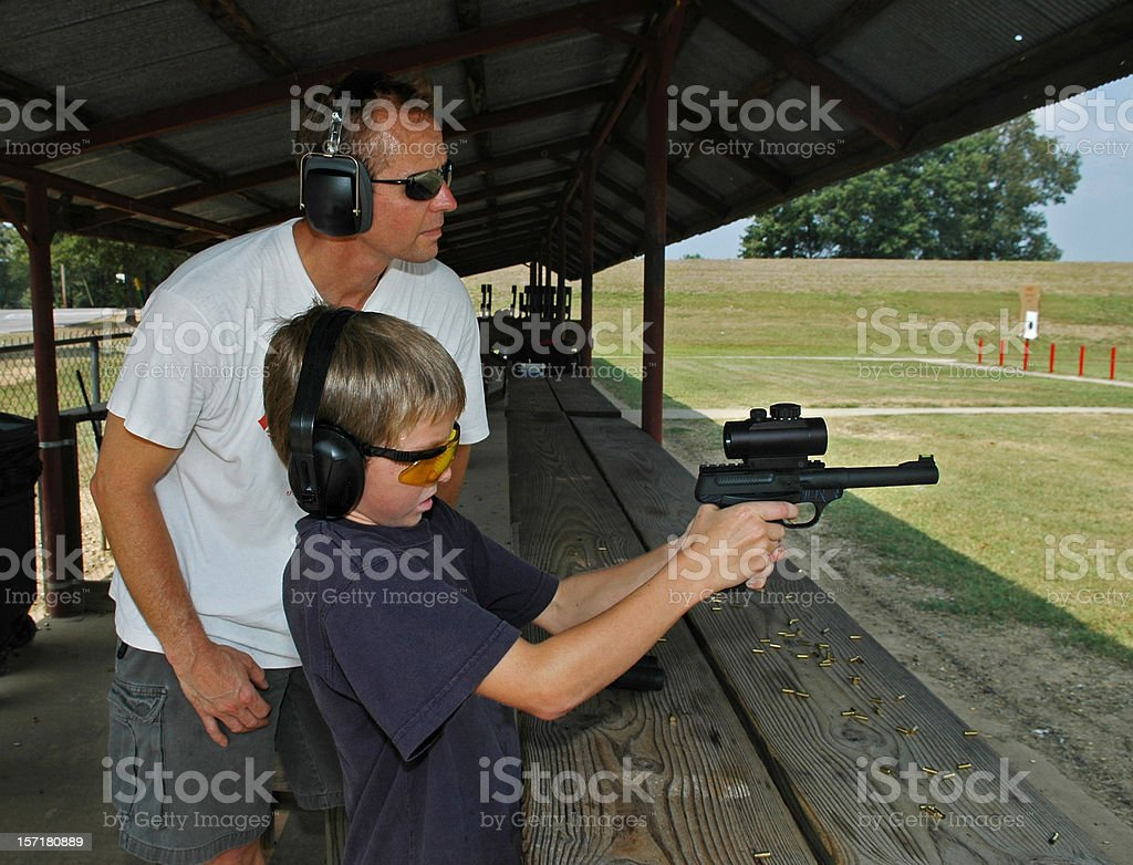 Father and Son Shooting Lessons royalty-free stock photo