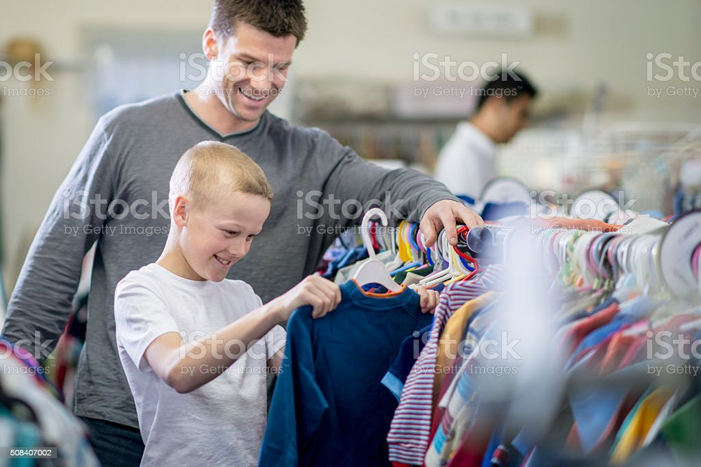 Father and Son Shopping Together stock photo