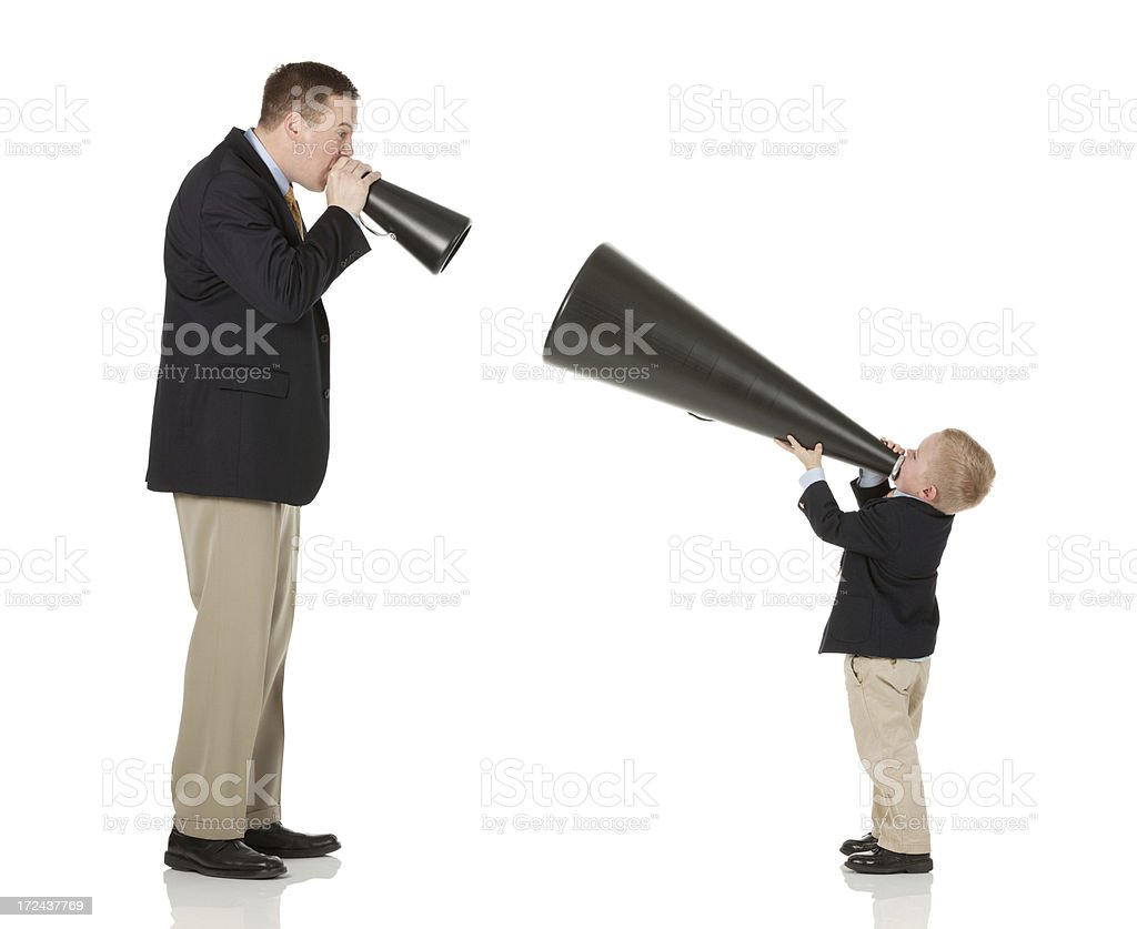 Father and son shouting into bullhorns royalty-free stock photo