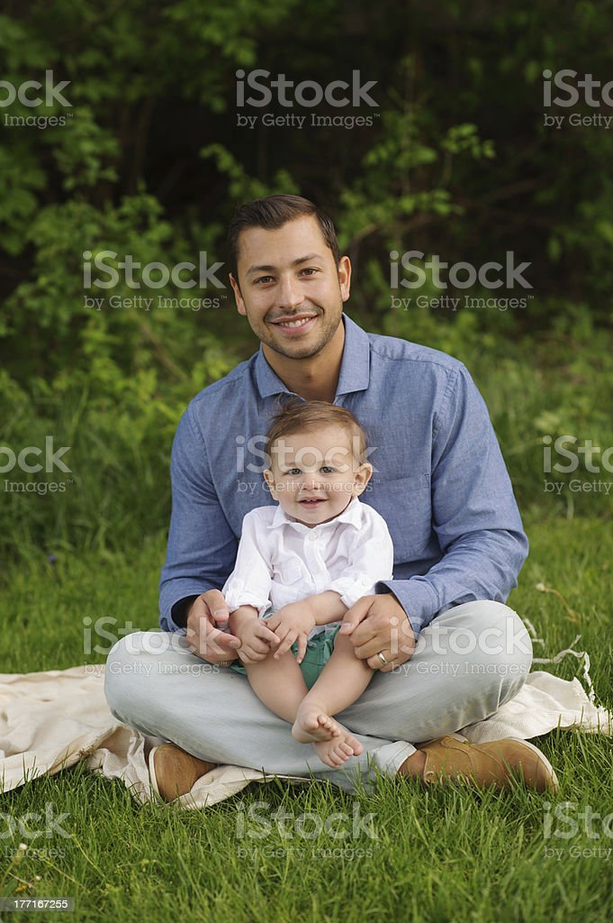 Father and Son Sitting Outside royalty-free stock photo