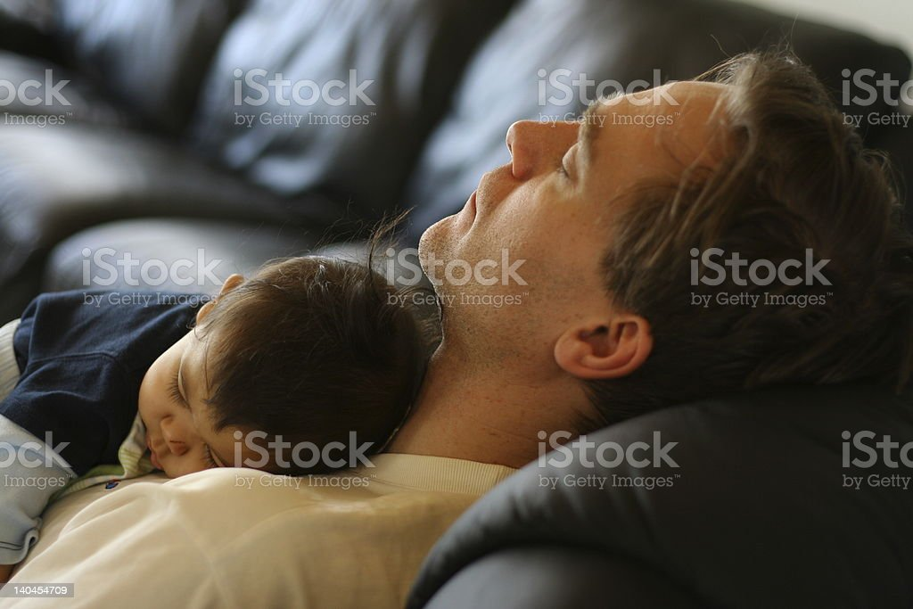 Father and Son sleeping like a baby royalty-free stock photo