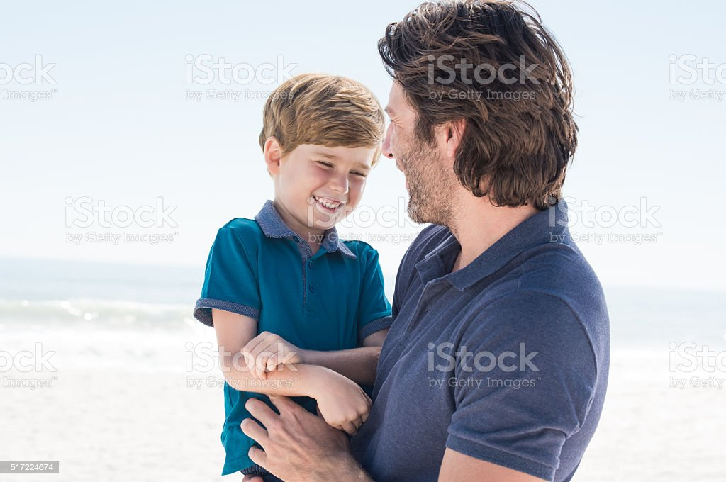 Father and son smiling stock photo