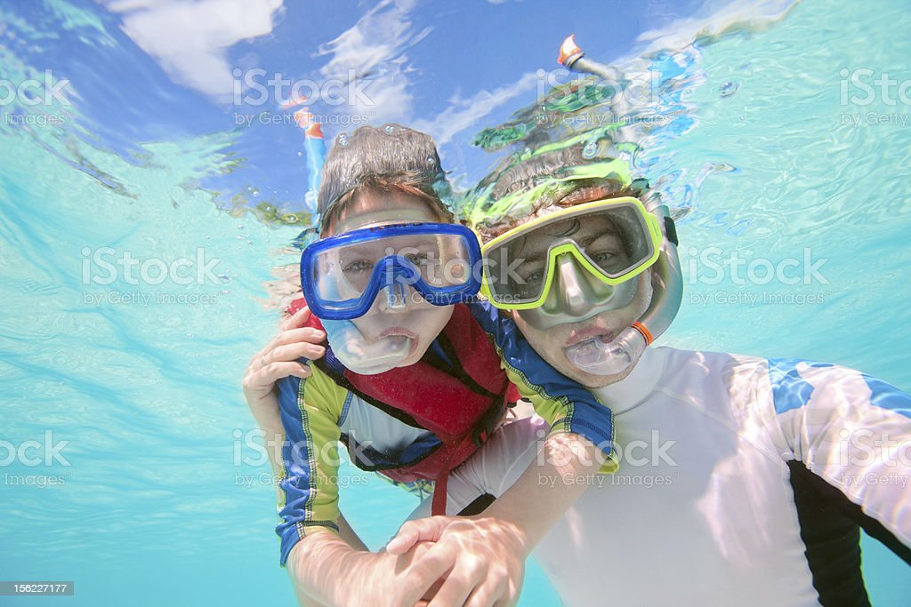 Father and son snorkeling royalty-free stock photo