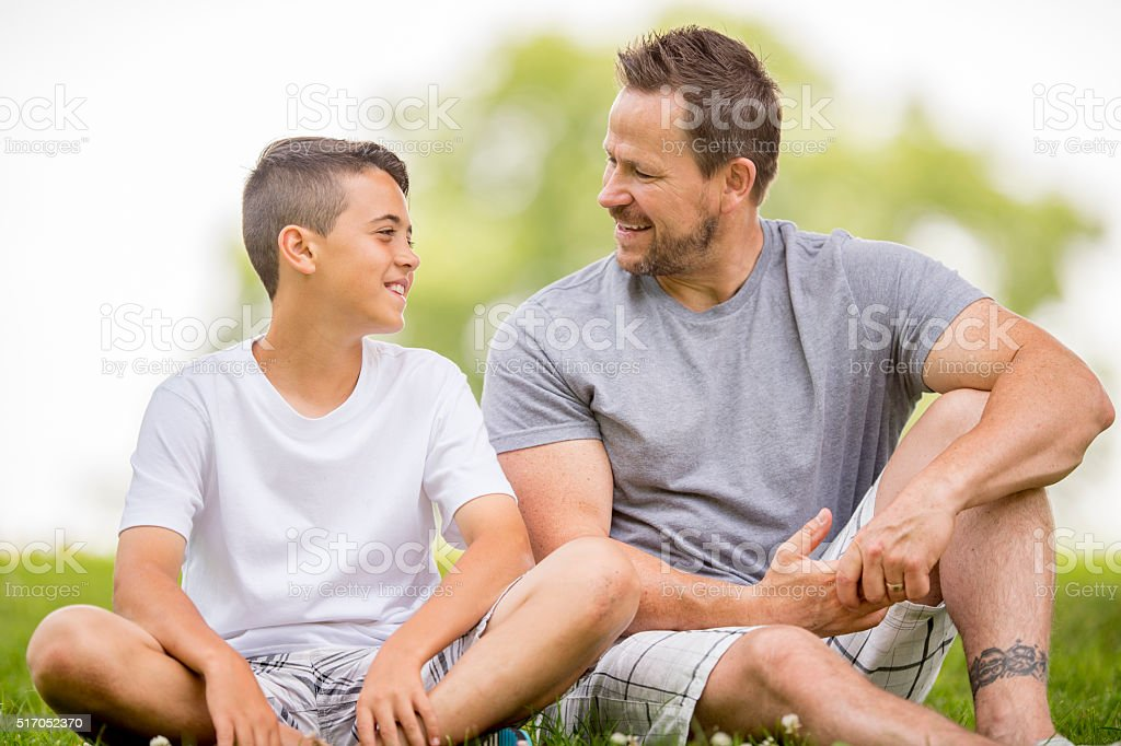 Father and Son Spending Time Together at the Park stock photo