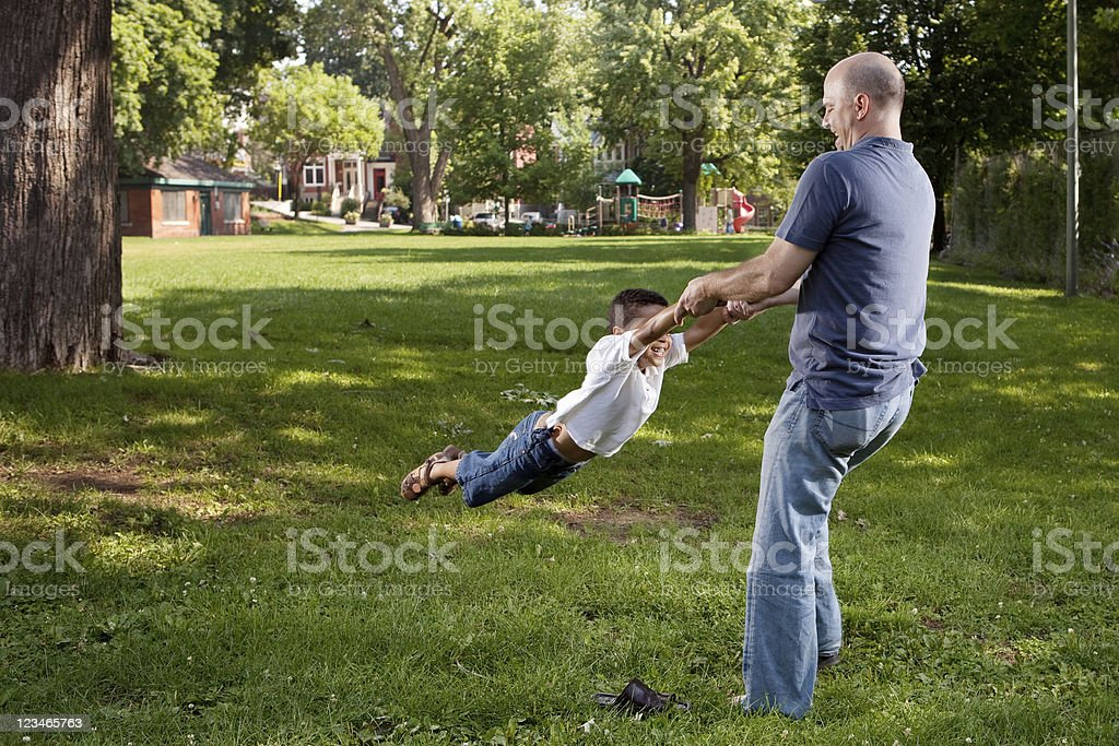 Father and Son Spinning stock photo