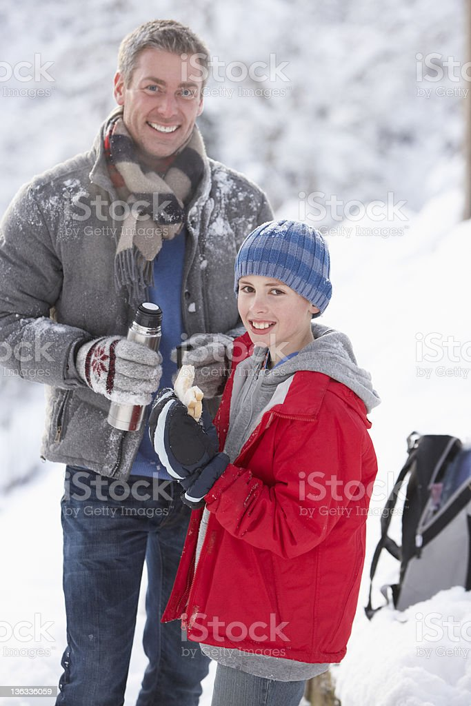 Father And Son Stopping For A Snack During Their Walk royalty-free stock photo