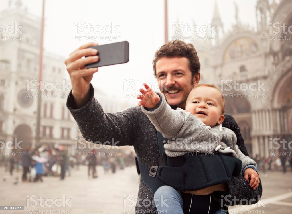 Father and son taking a selfie in Venice stock photo