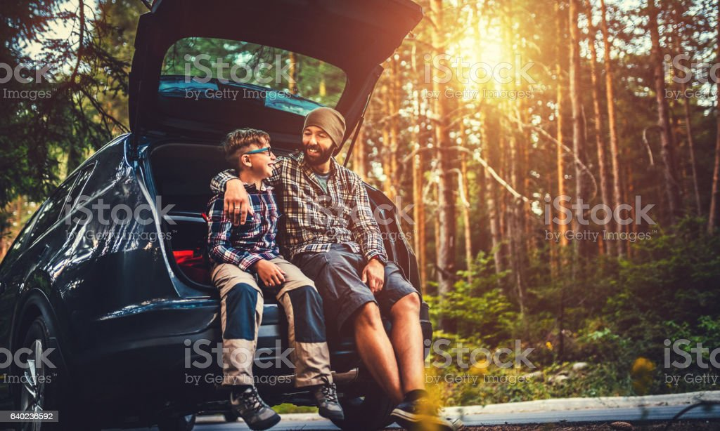 Father and son travelling by car stock photo