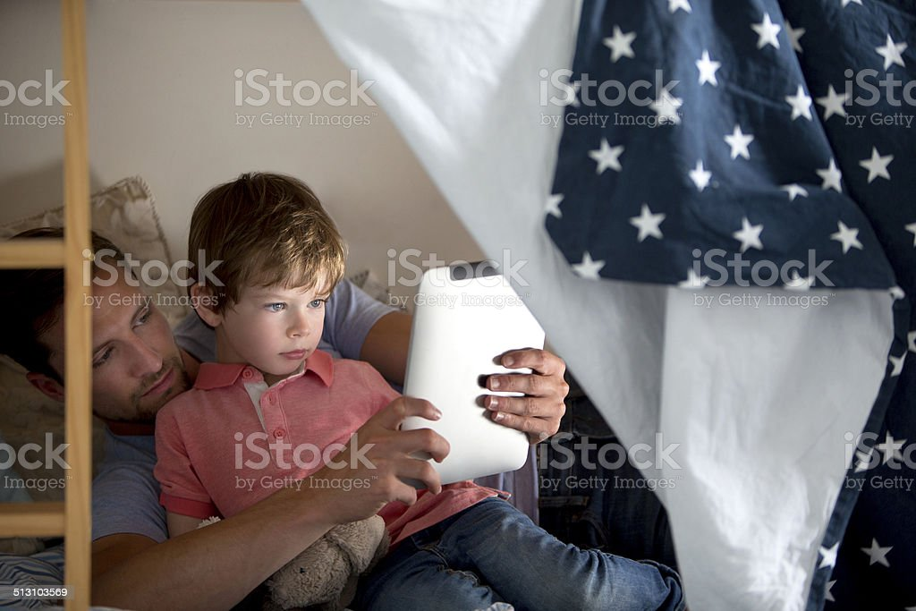 Father and Son Using a Electronic Tablet stock photo