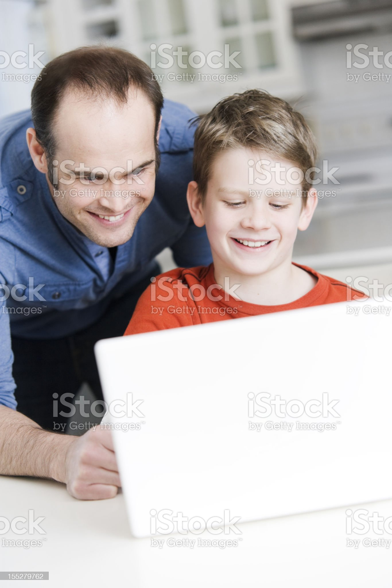 Father and Son using Computer royalty-free stock photo
