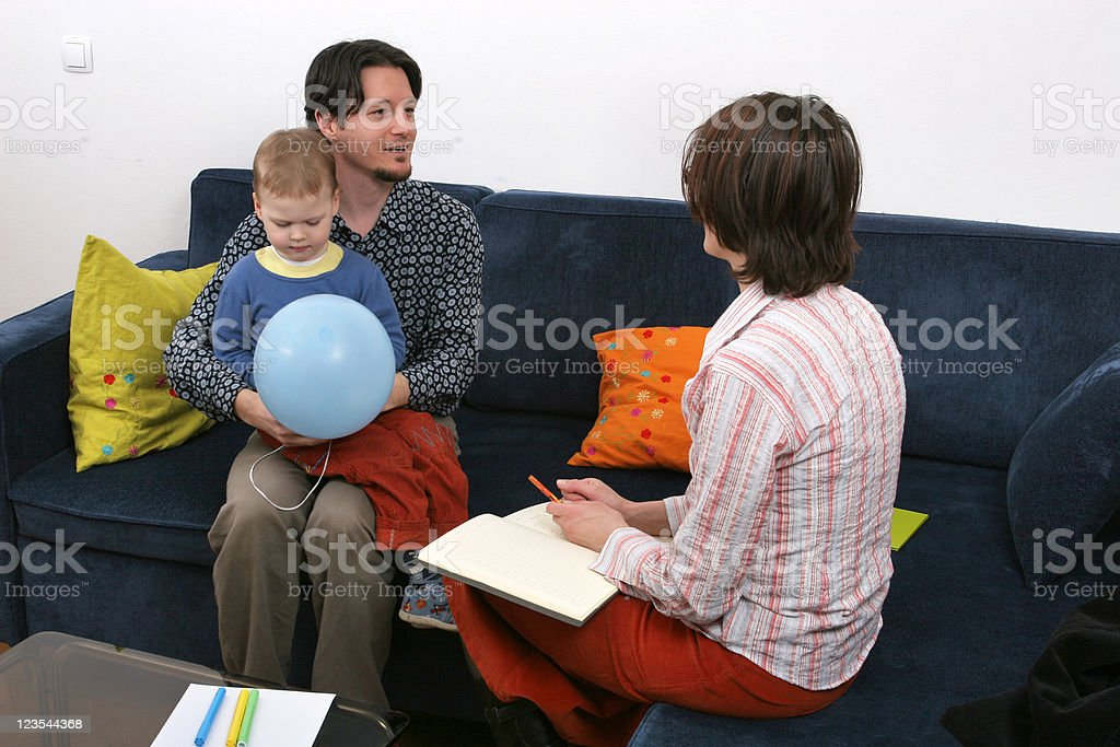 Father and son visit a social worker royalty-free stock photo