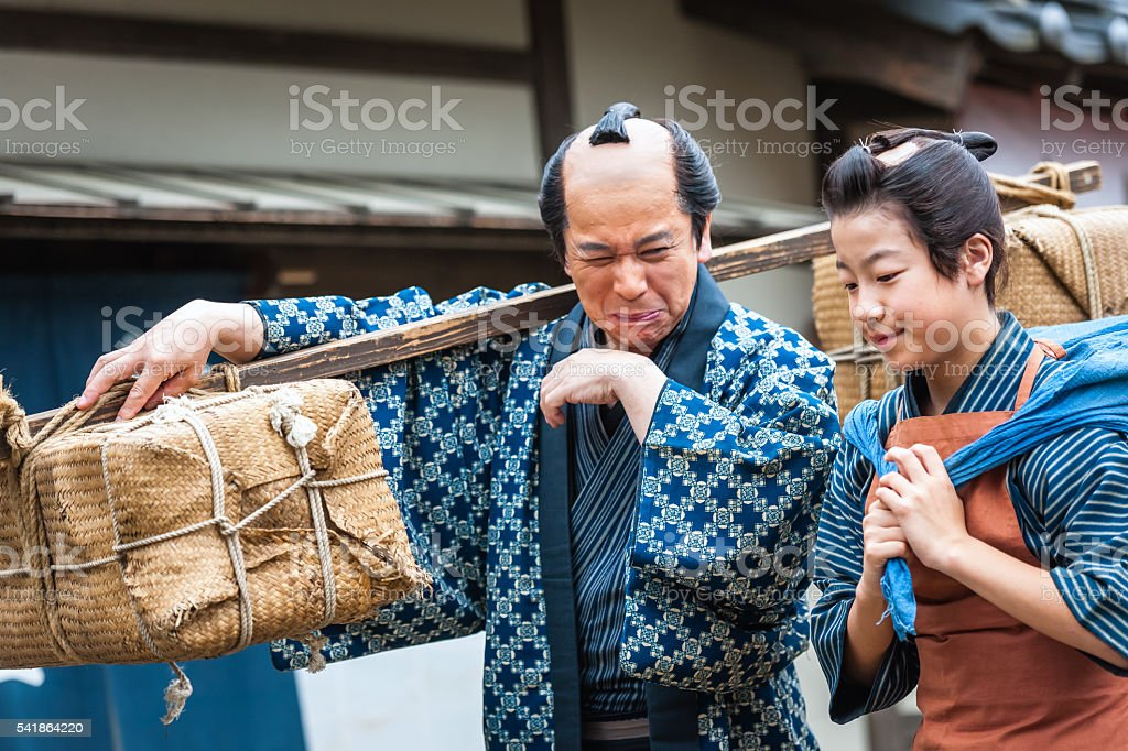 Father and son walk and talk,ancient clothing,Kyoto,Japan stock photo