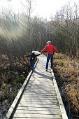 Father and Son Walking on Board Walk