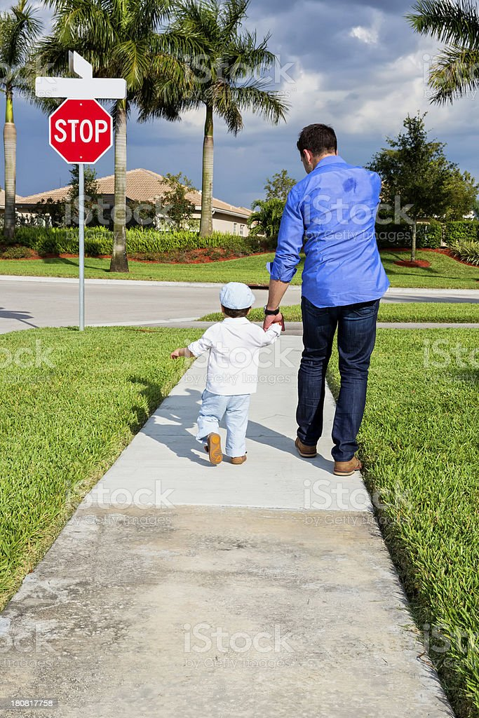 Father and son walking stock photo