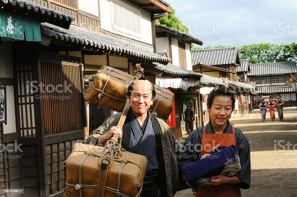 Father and son walking through the Japanese village stock photo