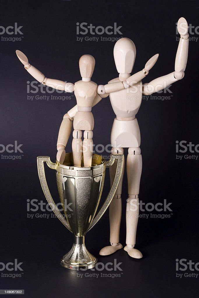 Father and son with a golden cup stock photo