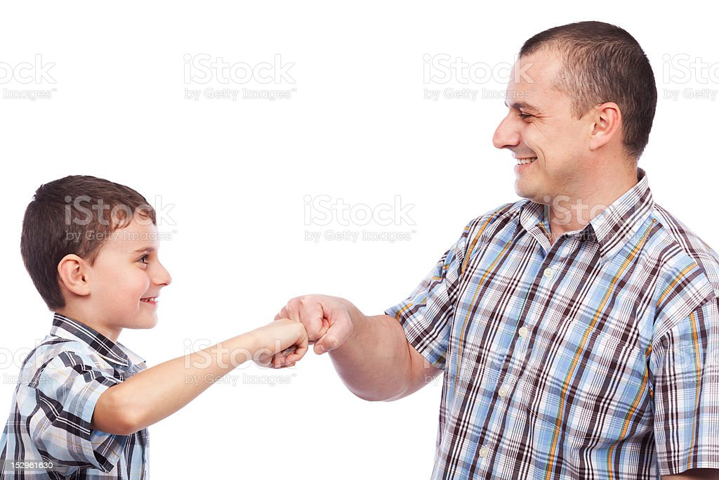 Father and son with a kind of high-five salute royalty-free stock photo