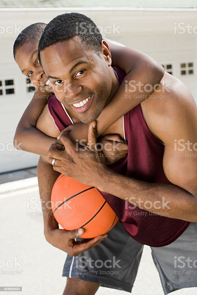 Father and son with basketball stock photo