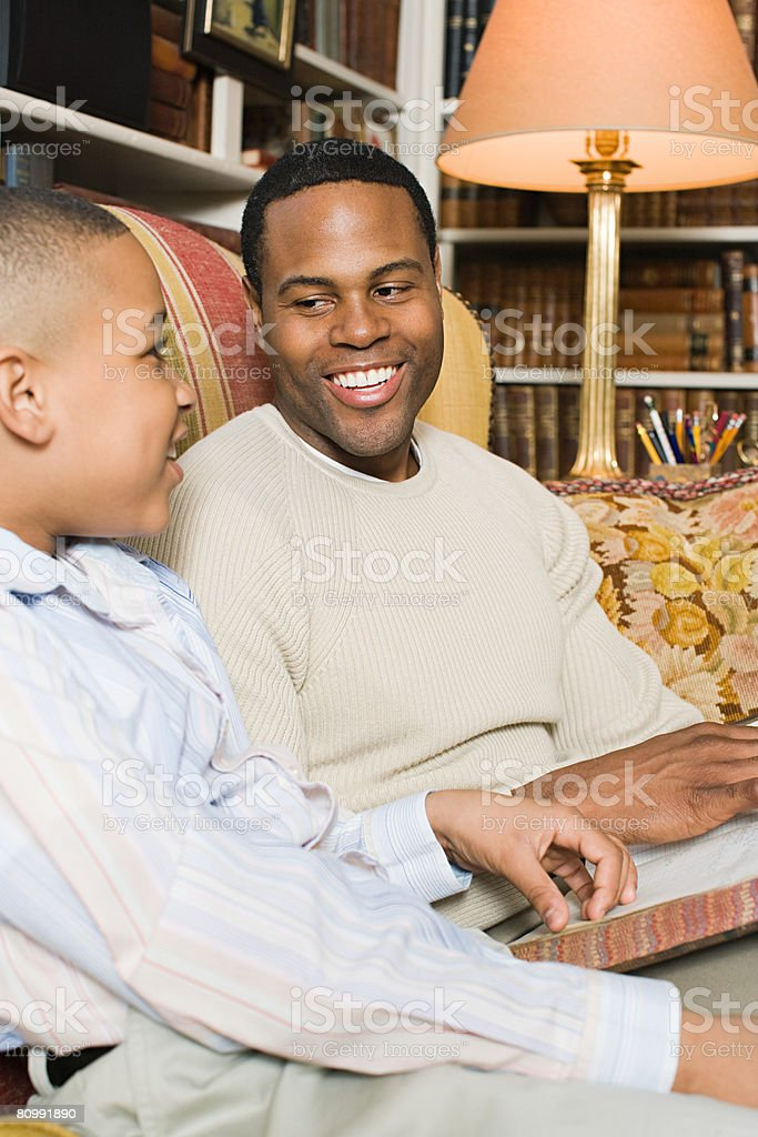 Father and son with book stock photo