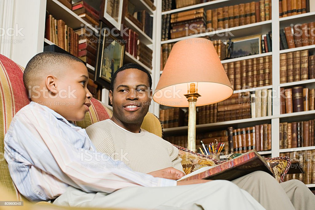 Father and son with books stock photo