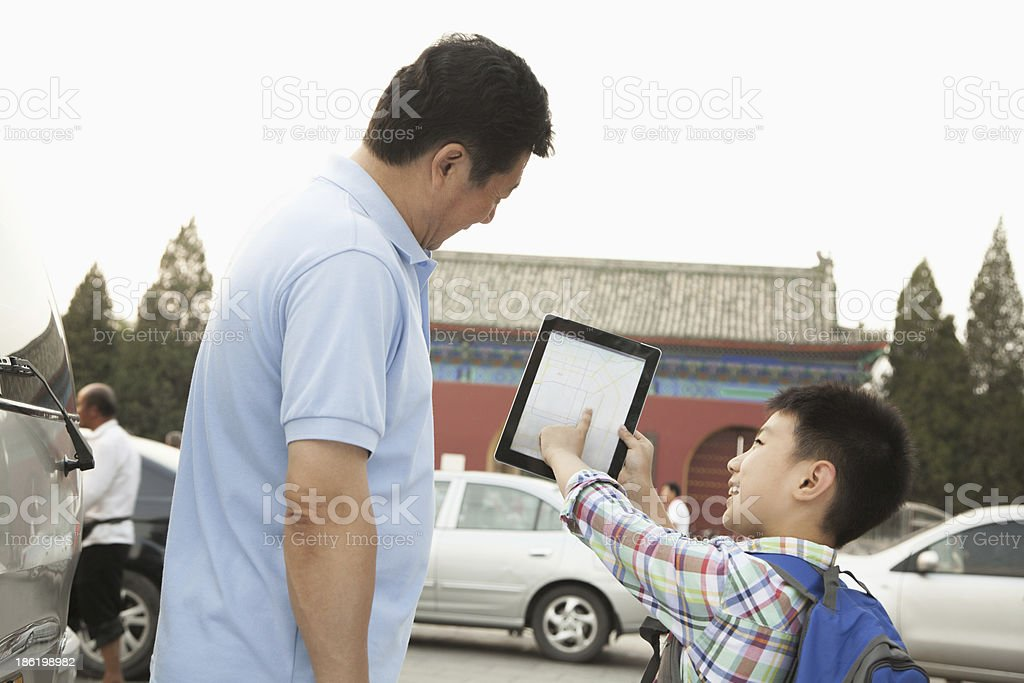Father and son with digital tablet royalty-free stock photo