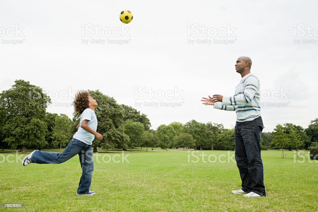 Father and son with football stock photo