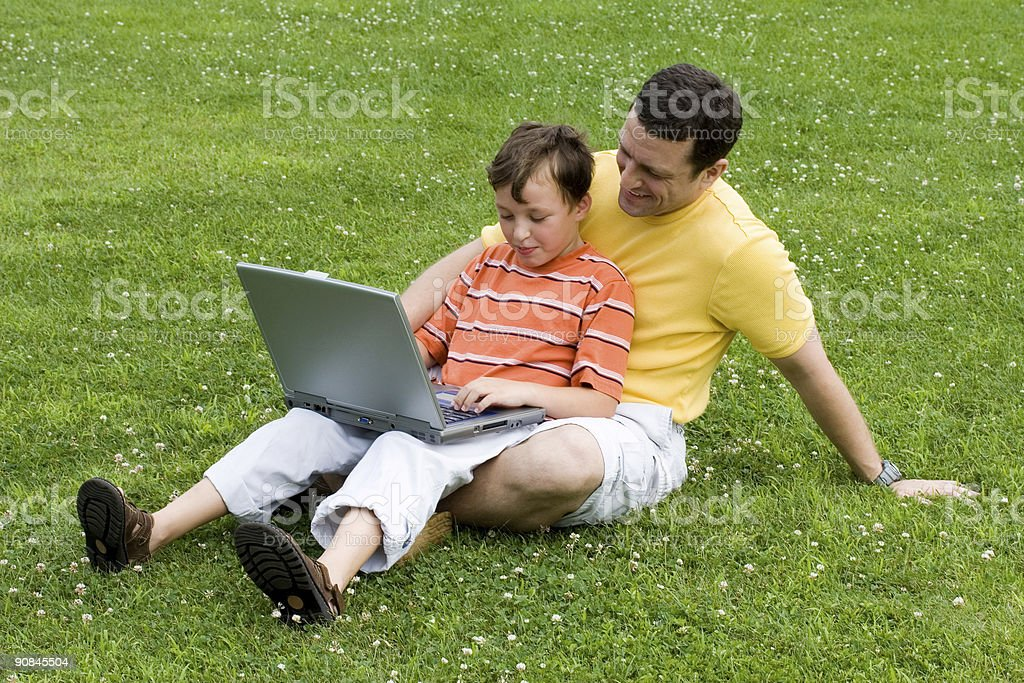 Father and son with laptop royalty-free stock photo
