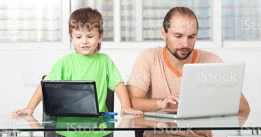 Father and son with laptops. royalty-free stock photo