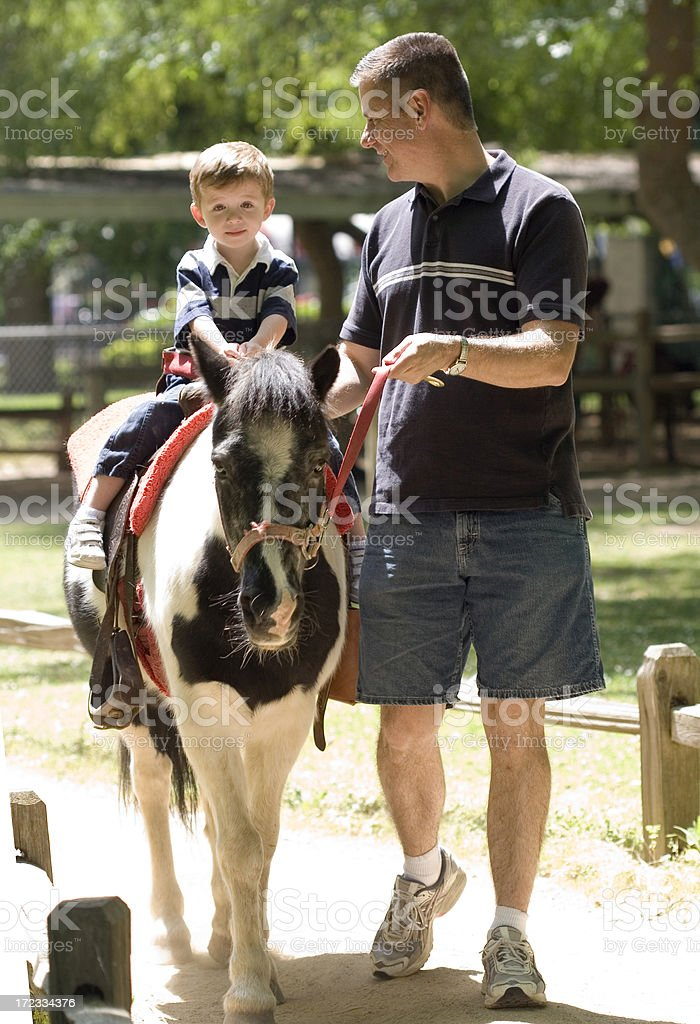 Father and Son with Pino Pony royalty-free stock photo