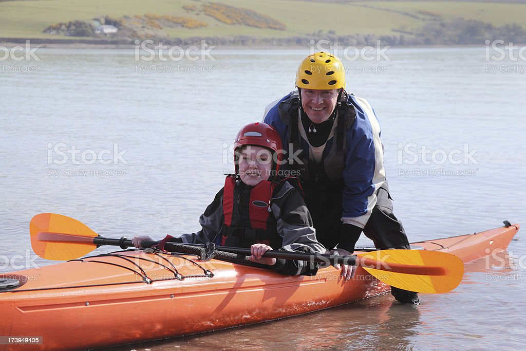 father and son with sea kayak royalty-free stock photo