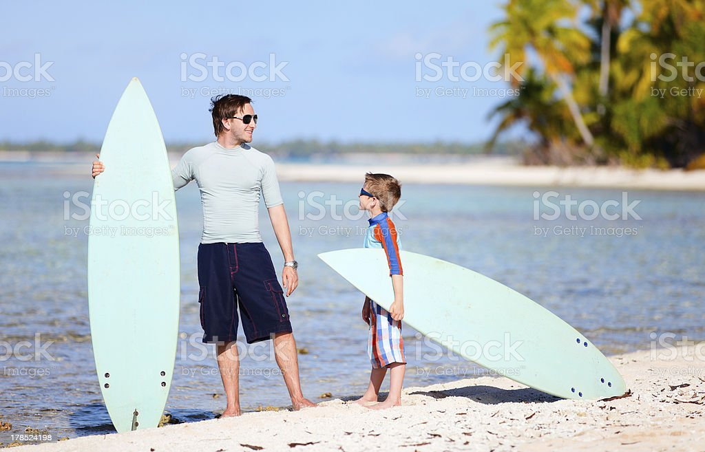 Father and son with surfboards royalty-free stock photo