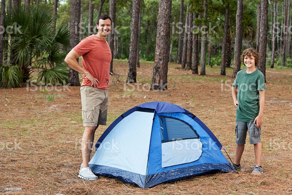 Father and son with tent on camping trip stock photo